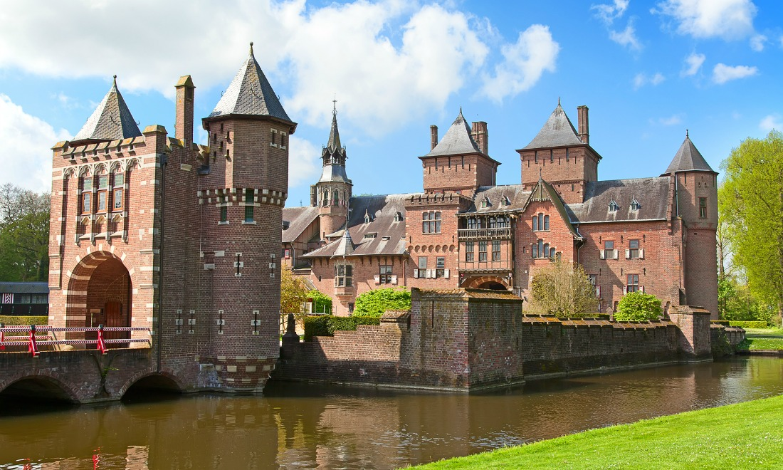 bigstock-ancient-de-haar-castle-near-ut-79846867.jpg
