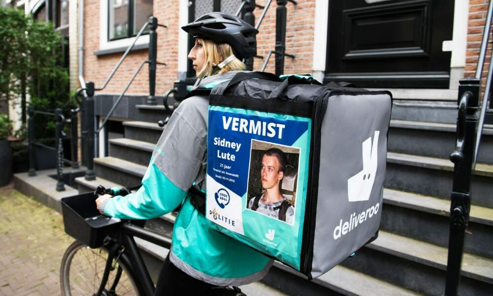 Dutch fast food delivery drivers display missing persons posters