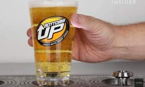 Bottoms up draft beer dispensing system