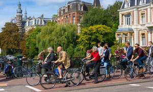 Full bike lanes and cyclists using smartphones in Dutch cities