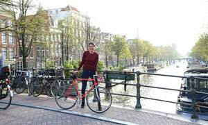 Win a copy of Ride with me Amsterdam or a free city bike tour