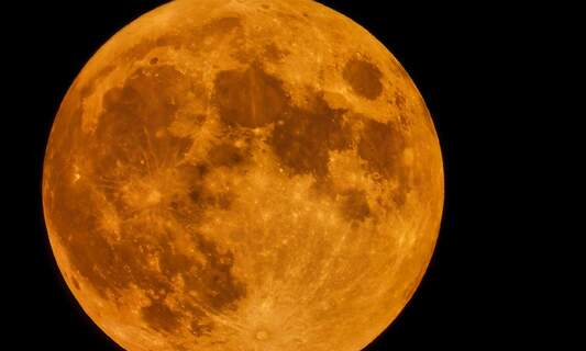 In pictures: King's Day's orange super moon
